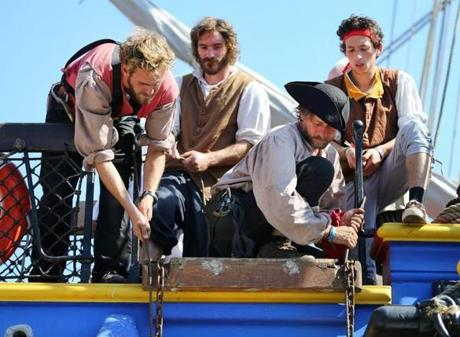 The ship's crew members lowered a gang plank.